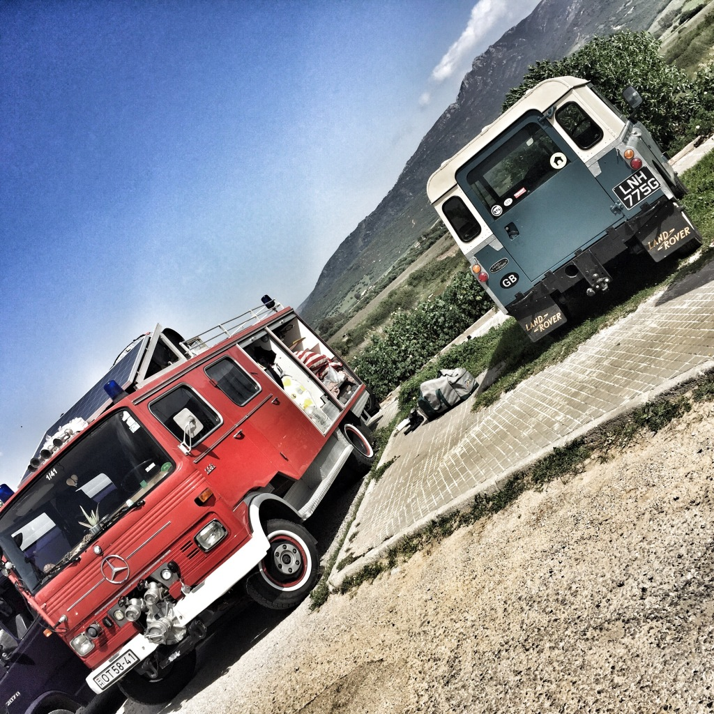 Vintage Land Rover series ii and fire engine